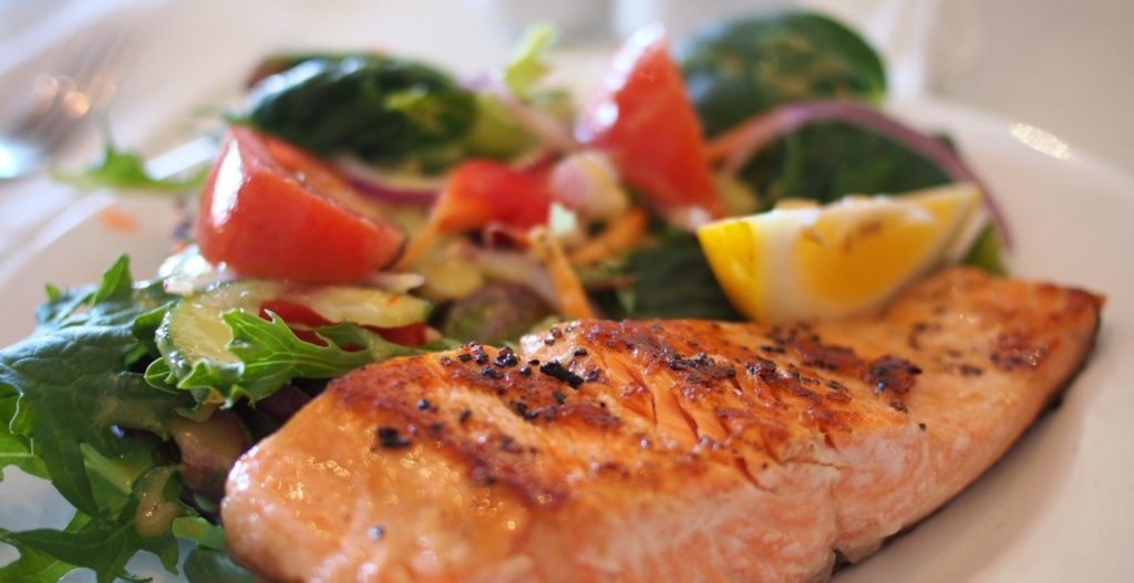 Plate of salmon and veggies. healthy healthcare food