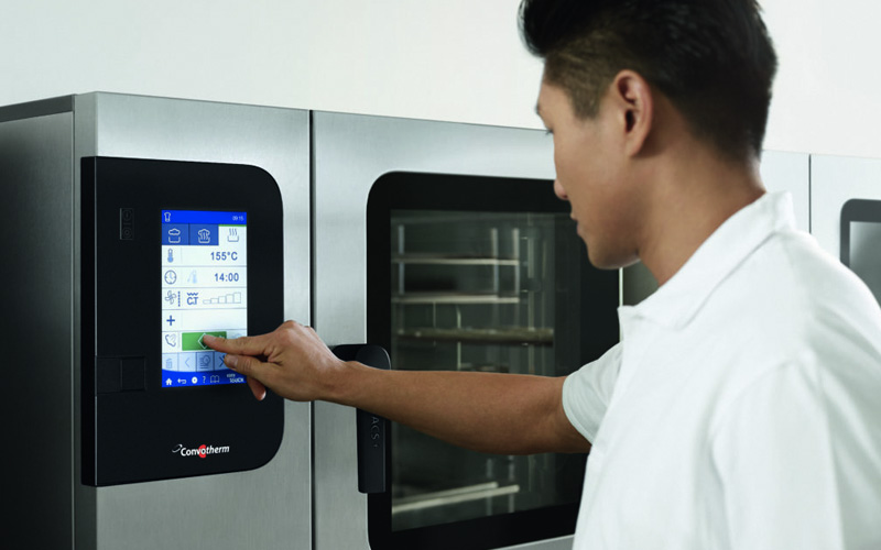Man using a Convotherm touch screen oven